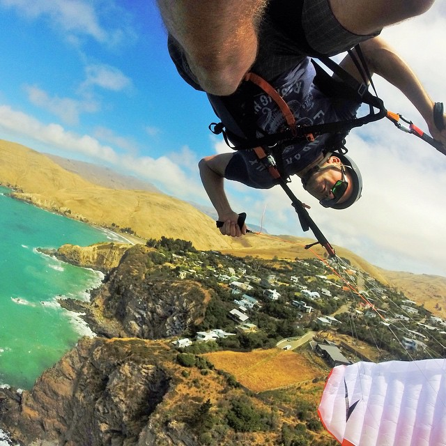 Photo of the Day! Scott Merriman speed wing soaring upside down at Sumner Cliffs in New Zealand. #GoPro #speedflying #NewZealand