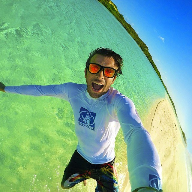 Leaping off of a sandbar in South Caicos while sporting the North Shore Solo! Kameleonz.com