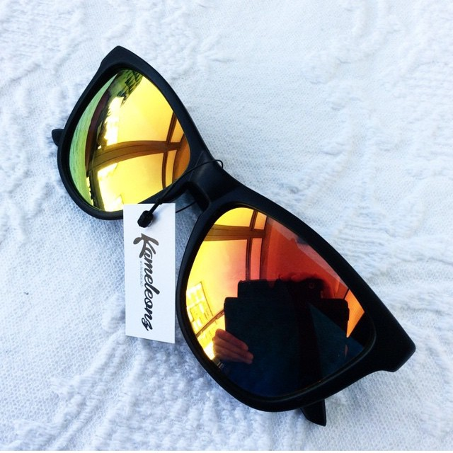 Relaxing with North Shore Sunglasses that'll match any color combo you can think of!  Kameleonz.com