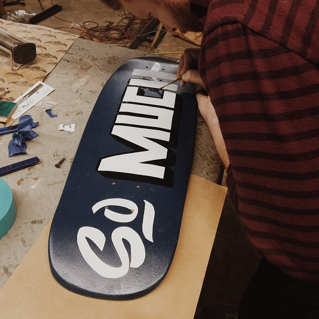 Schuyler in here working on a hand painted one off. #handmadeskateboard #handmade #signpainting #Nashville