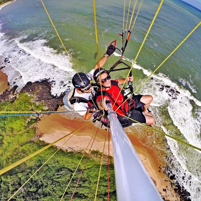 Paragliding over the ocean in Rio de Janeiro, Brazil. Photo: @giovan_alex #gopro #gopole #gopolereach #paragliding #riodejaneiro