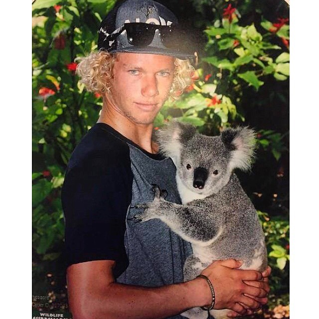@john_john_florence takes a break from cuddling Koalas to surf his #QuikPro heat, live now through the link in our bio.  #SEEHAPPY