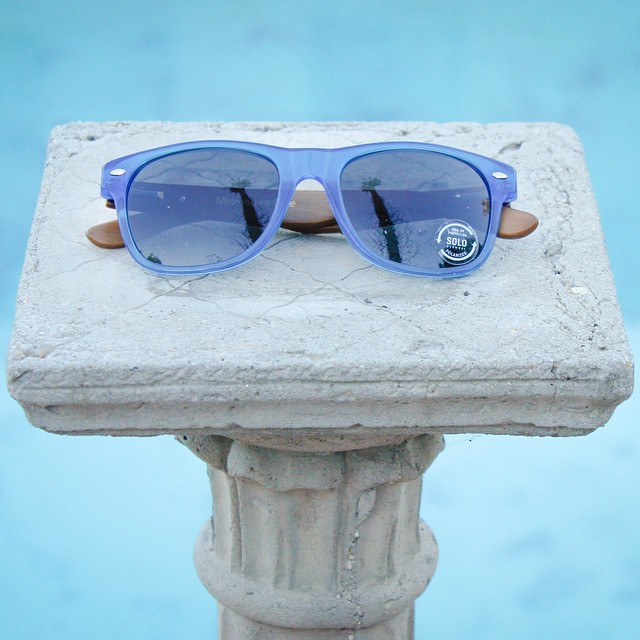 Leave your Monday blues at home and start your week right with SOLO Bamblues! #soloeyewear #mondayblues #bamblues #sandiego #palmtrees #bamboo #sunglasses #pool