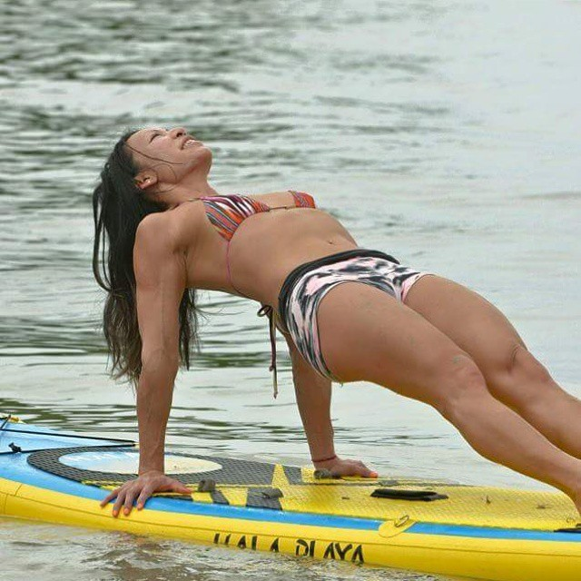 Fitness instructor, Cindy Lai on the Hala Playa. Photo: @suppaulclark #halagear #halaplaya #supyoga #sup #standuppaddle #stand_up_paddle #fitness #theweeklyinsta #repostmysup #yoga #paddleboardyoga #panama #paddleboard  #balance
