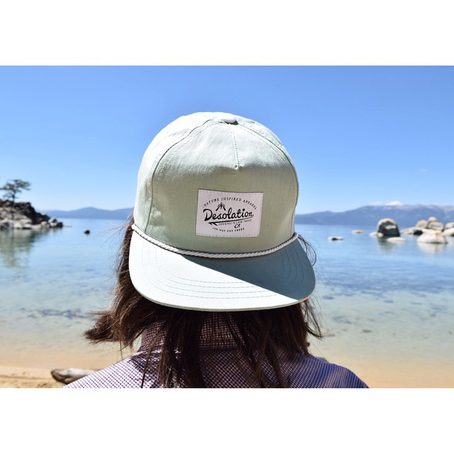 Our dude @messymessi admiring her beauty in the @desolationsupply camper cap.  Photo: @warpwave _ #tahoemade #itswayoutthere #thisistahoe #desolationsupply #madeinCA