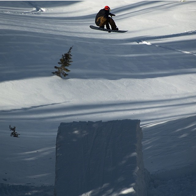 Jonny Sischo (@winterislove) getting some of the air up there in the Montana backcountry...photo by @jordaningmire