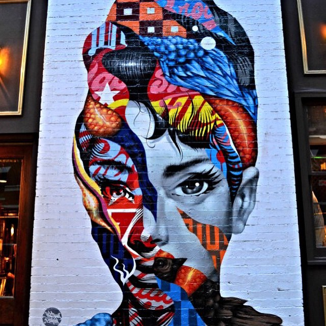 Work by @tristaneaton done in Little Italy, New York #audreyhepburn #mural #thelisaproject #streetart #cafferoma