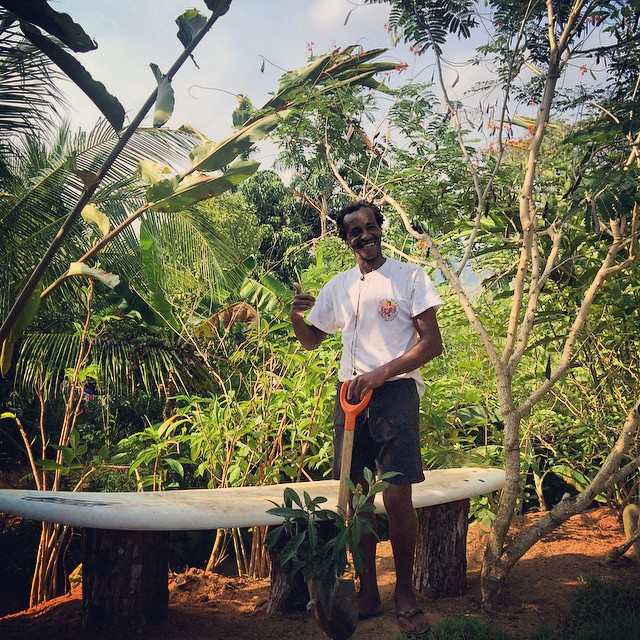 Our friend, Filo, helping us reuse and repurpose old surfboards and turn them into benches around the Bodhi Surf Lodge! Creative and useful!
