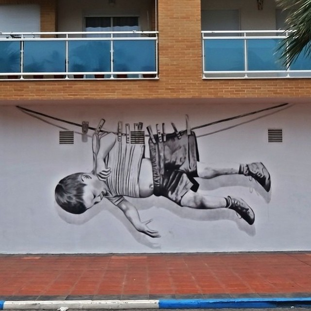 Hung out to dry | Work by @jorgepina | #streetart #mural #clothesline #dope #graffiti