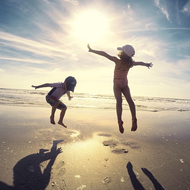 Photo of the Day! Not much beats a sunny day at the beach. Photo of Laney and Cole jumping for joy by @Jennifer_Matthews. #gopro #family #beach