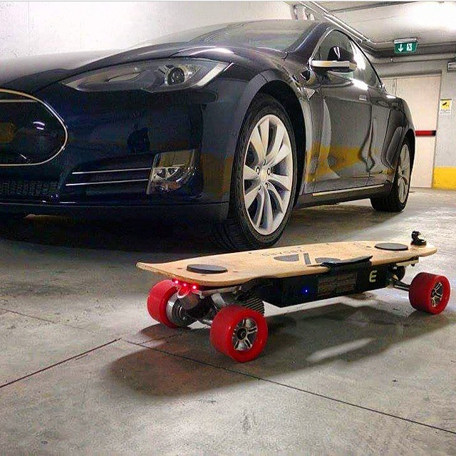 A nice ride deserves nice wheels... Red Urethanes now back in stock! #zboard #tesla  Regram from @cintugram in Milan.