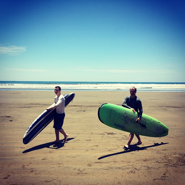 Learning to surf together, a great father-son activity and one for the books!