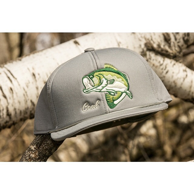 """I caught you a delicious bass."" The Wilderness Spring hat is great for fishing or flirting."