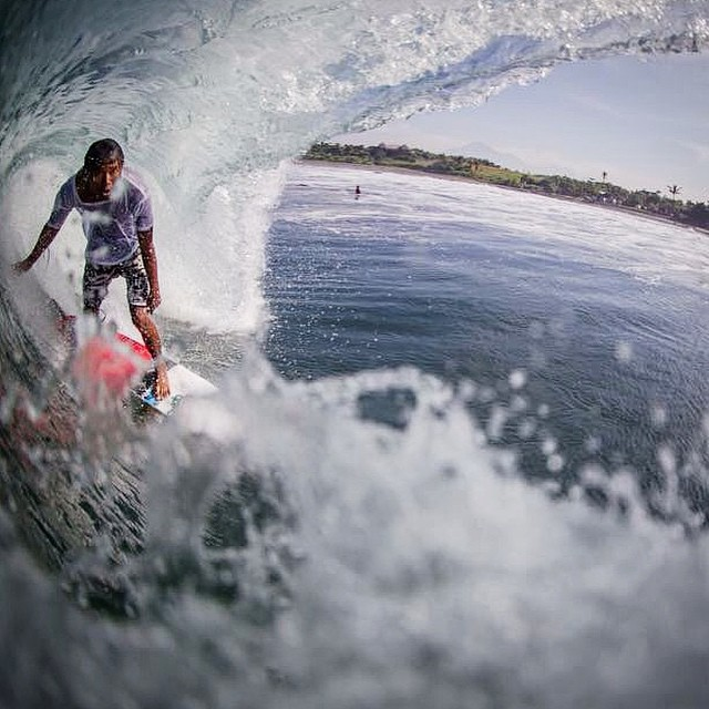 Fun swell the last couple days in Bali, been fun seeing the crew get some good ones... Here @black.dawgg  gets a little cover from the ☀️ thx for the