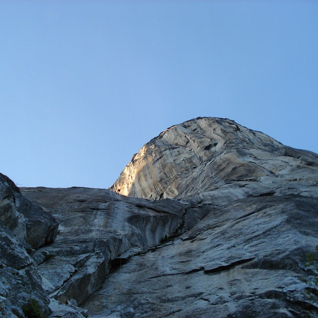 A climber rappels off the bottom of The Nose of El Capitan in @yosemitenps, dwarfed by 3,000 feet of rock above her. This week is #NationalParkWeek. Do you have plans to visit a park this year? Which one?  #MountainCrushMonday #FindYourPark #elcapitan...