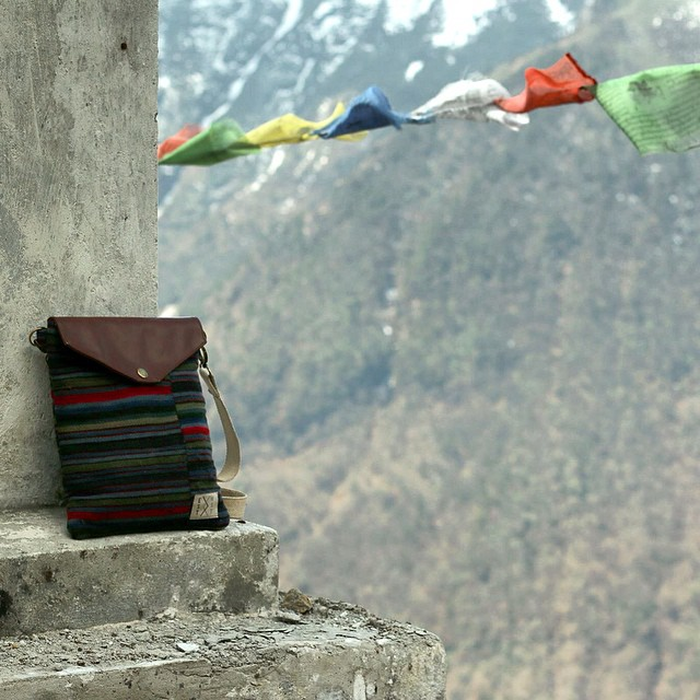 Himalaya iPad Sling back to it's roots in the Himalayas. Each sling from this collection uses a one of a kind wool apron, dyed naturally and hand woven in Tibet. #handwoven #ethical #textiles #traditional #tibet #himalayas #consumeconsciously...