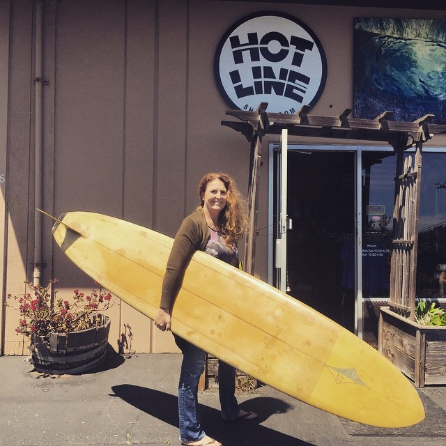 In honor of the Log Jam here's Hotline's founder Brenda with her first surfboard; a 1967 Doug Haut.