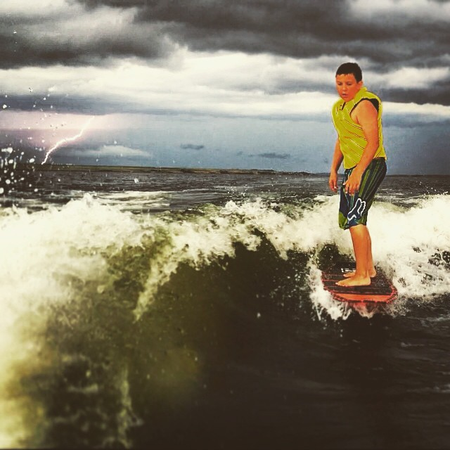 Tynan Lemon from Saskatchewan, CAN times the perfect shred shot with some lightening! #maybetimetogetintheboat Send your best wakesurf moment to info@slayshTank.com for some fresh air. #wakesurf #wakesurfing #slayshTank #keepitfresh