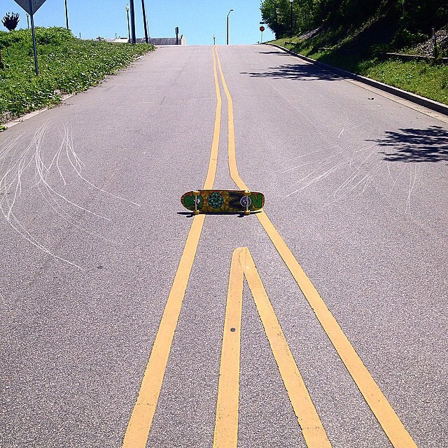 Josh Dunn--@beautyoutofbabylon painting asphalt on his Da Kine!  #bonzing #dakineskateboard
