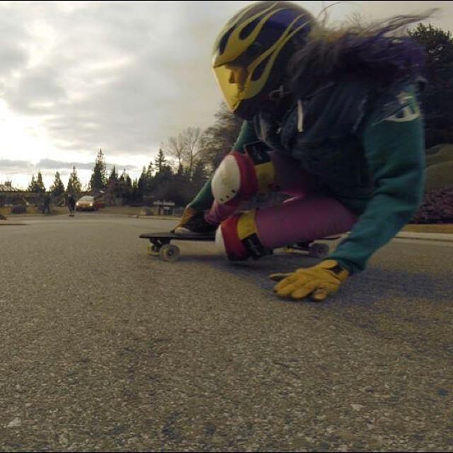 @rachel_rayne sliding toeside into a fast,wet corner in West Van. Pic Danny Carlson #longboardgirlscrew