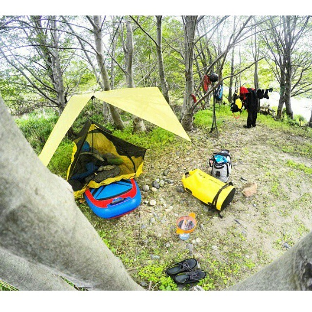 #Repost from @suppaul_pics ・・・ SUP camp. I've really taken to sleeping on my board at camp. The Sea to Summit Escapist bug tent and tarp make it cozy. The board is a bed and a chair, making any surface flat. Hala! #halagearsup #seatosummit #yeticoolers...