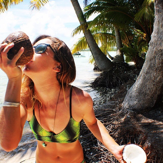 Who's thirsty?! Happy #thirstythursday, mermaids! @babeinthewaves gets into it in our Reversible Wrap Top #getoutthere #drinkup #coconut #cuckooforcoconuts #miolagirl