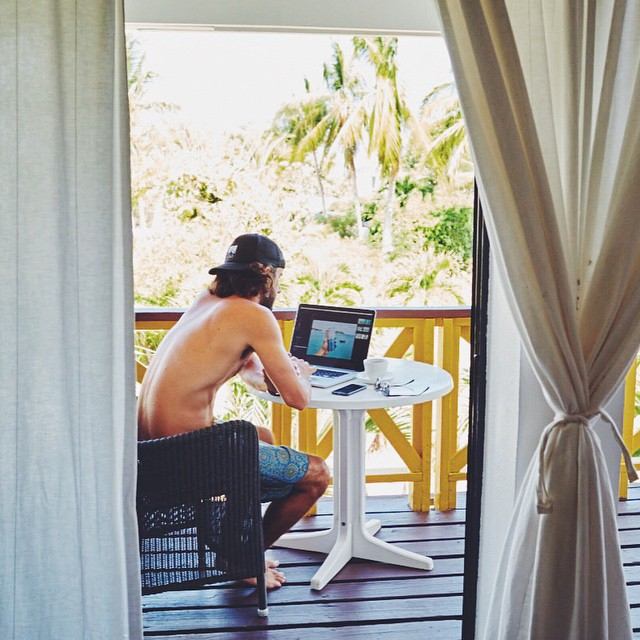 "Monday office inspiration: @riverjordanphoto in his ""field office"" in the British West Indies as captured by his lady and fellow shutterbug @hellochristinrose. This creative duo takes their gig on the road by sailboat, truck, surfboard, you name it...."