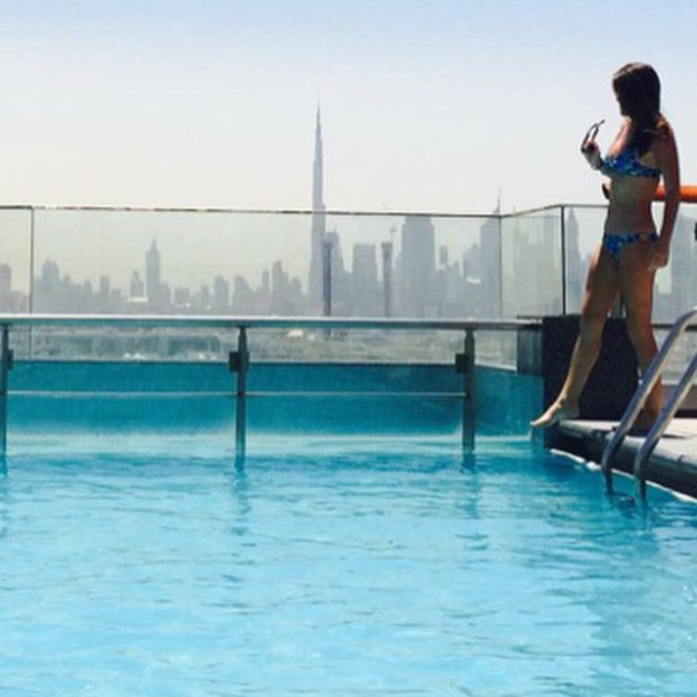MI OLA goes to Dubai... @mermanda_ in her #miola bikini with a view of the tallest building in the world