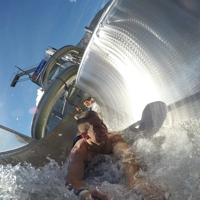 A little fun in the sun in the Austrian Alps.  Pro mountain bikers, @SamPilgrim and @SzymonGodziek show off how pros take on a water slide. #gopro #area47