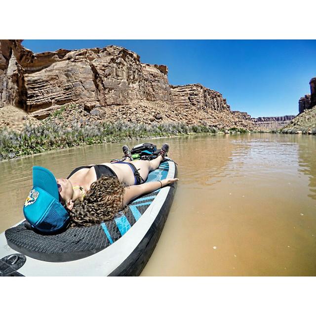 @gnardia relaxing in Savasana on the #HalaAtcha  in the Colorado River. #HalaGear #sup #theweeklyinsta #adventureladies #outdoorwomen #heidimicheledesigns #supyoga #namastesup #localhoneydesigns #astralbrewess #astralfootwear #namastesup