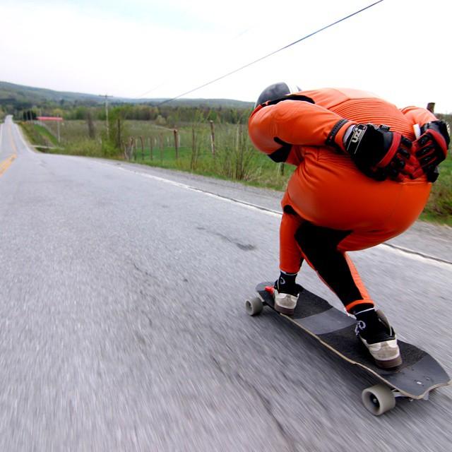 Team rider @niko_dh hitting over 100kmh on this classic Quebec run.  Brand new orange cow skin for him!  #restlessboards #restlessnkd @samblaizz photo