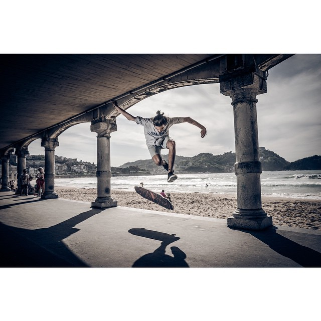 @blinlongboard flips it in Europe. photo @unai_bellamy