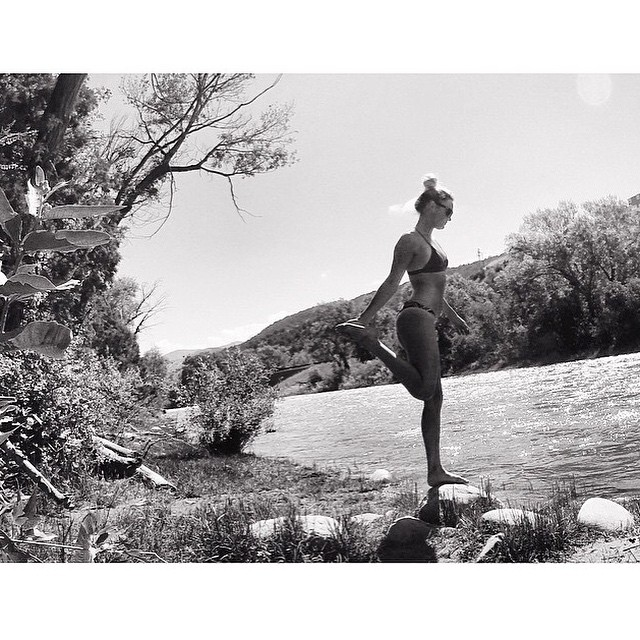 Standin' on a rock || @meredithdrangin in #blackandwhite || #getoutthere #balance #miolagirl #yogaonarock #colorado #beactive