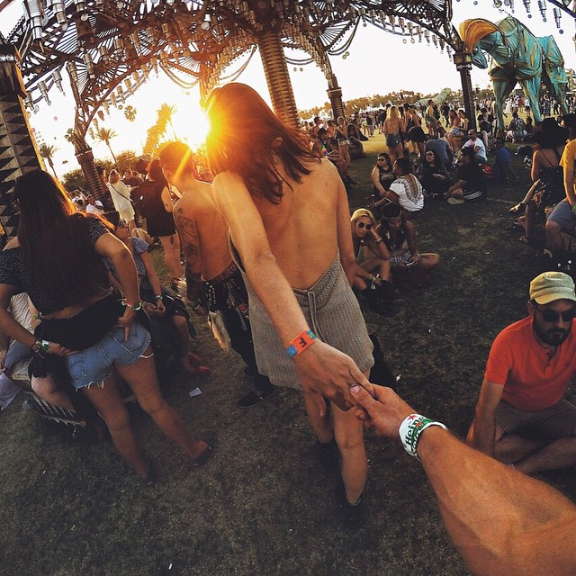 #FollowMeTo @Coachella! @sopheenis leads the way between festival stages at golden hour. Photo by @tomcascino. Share your best music photos with us by clicking the link in our profile! #Coachella #GoProMusic #FestivalLife