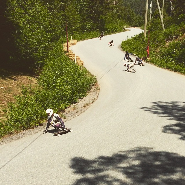 Team rider @speedscientist leads a pack of riders during practice at the 2015 @britanniadh in British Columbia. Qualifying is going down today and racing on Sunday. #dblongboards #britanniabeach #britanniadh #britishcolumbia