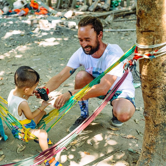 Old world meets new world in Hainan, China.  A connexion moment between @kepaacero and a local kid during this year's edition of the #NixonSurfChallenge, captured by @bastienbonnarme  More pictures on Nixon.com/surfchallenge @monsterenergy @reef_europe...