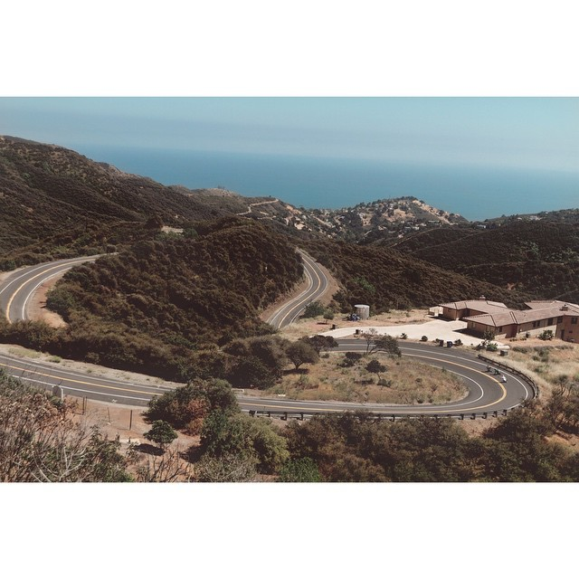 @radzani @ed_garn_long and @liam_lbdr_ trace a snaking canyon road to the ocean.