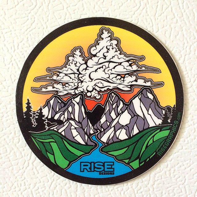 Close up of one of our new stickers. Come by the shop and grab some! #stickers #risedesigns #riseshop #mountains #clouds #tahoe