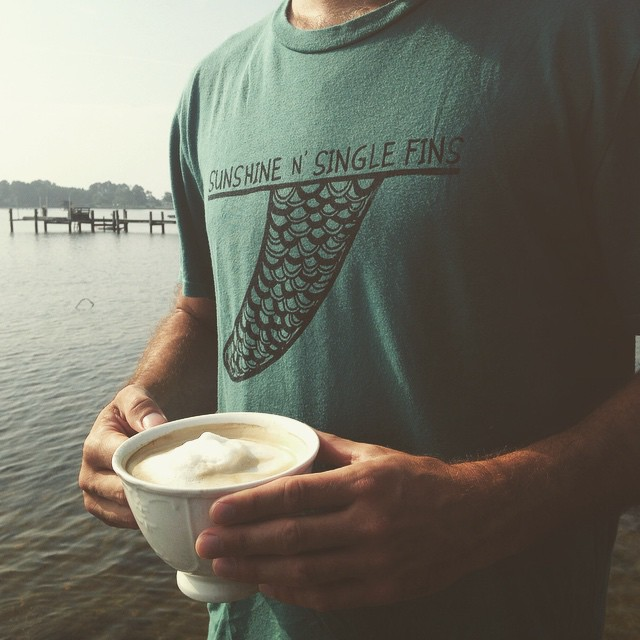Peaceful dockside morning with a homemade almond milk latte and our Sunshine N' Single Fins tee