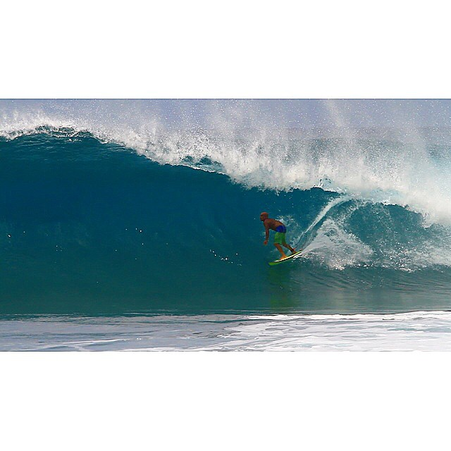 The ageless #MichaelHo driving through yet another heavy Hawaiian tube.