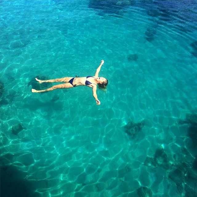 #regram of @stephaniegilmore lapping up the crystal clear waters of Tahiti. #ROXYready