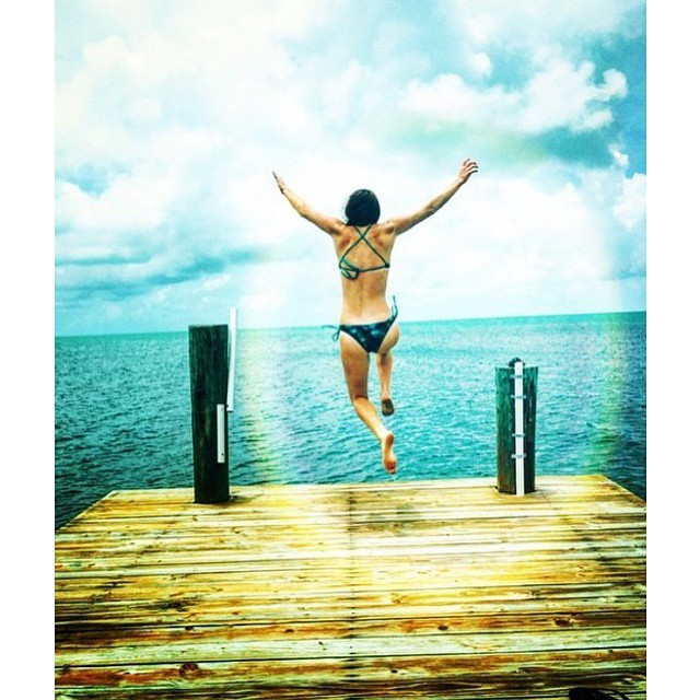 #miolagirls leap || dock fun with @mermanda in our X-Back Top and Double String Bottom || #getoutthere #miolawesome #jumpforjoy #dockjump #takealeap #tgif #fridayfunday #floridaykeys