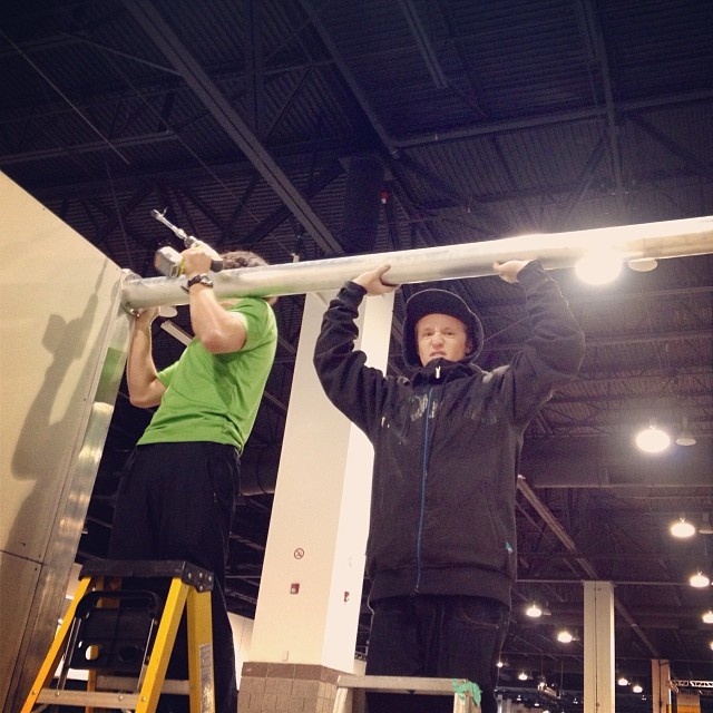 @stevewweiss and @dtd801 using their man strength to put the booth together. #sia14