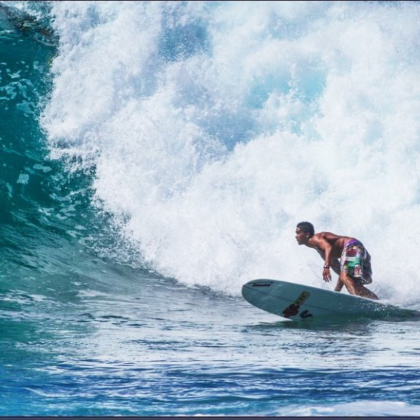Team Rider @nelsonahina_3rd bottom turning before a massive wall of white water. Not too mention, looking stylish in his pair of Protest Shorts: Evict Monsanto too! #inspiredboardshorts
