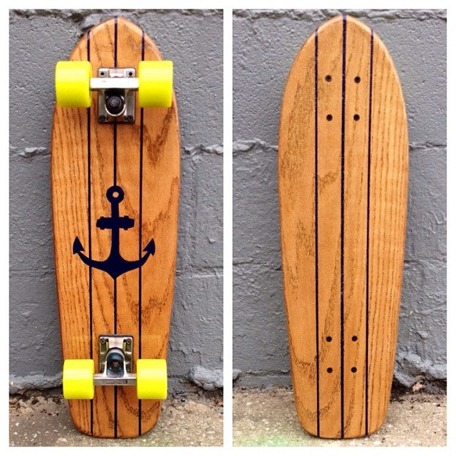 "Someone should come snatch up ""The Victor."" Beautiful Honey Oak board with navy paint and lime wheels!"