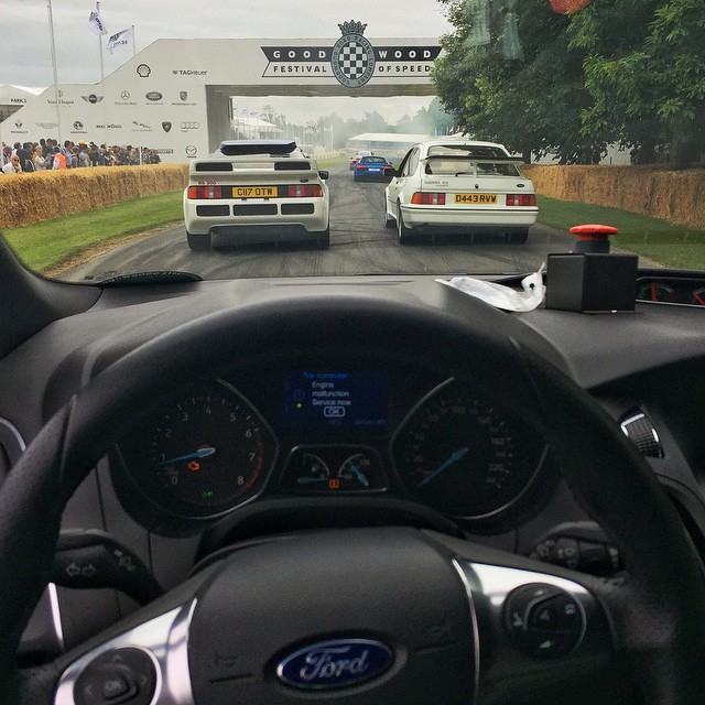 Last lap of the last day of @FOSGoodwood. Sitting here behind the wheel of a Focus RS test mule, enjoying the view ahead of me: my favorite rally car ever - the Ford RS200 - alongside a Sierra RS Cosworth. RS squad holding it down in front of the...