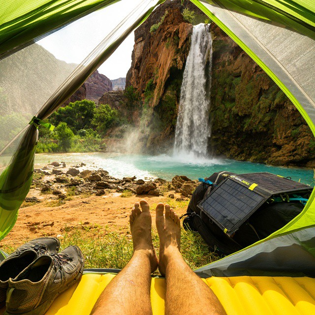 After a ten mile hike, @chrisburkard kicks his feet up and takes in the view of Havasu Falls. #GetOutStayOut