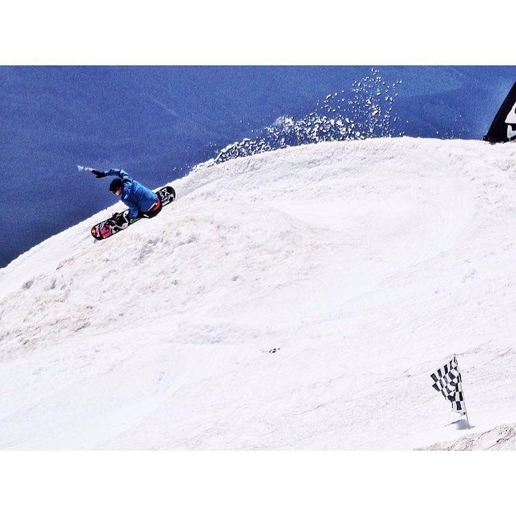 Super shred @ben_ferguson slashes the slush at the #ratrace last week. Summer snowboarding rules.