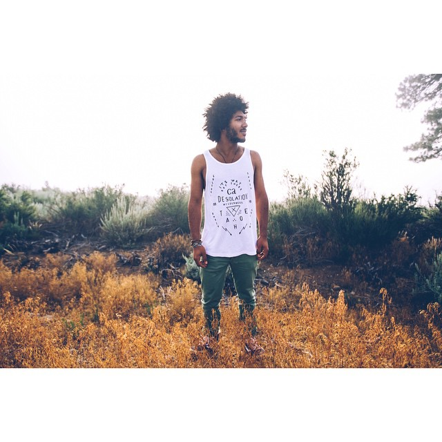 The men's Culture Shock tank in white. Available online, at our pop-up shop this Thursday at #SummerGather15 in Tahoe City, and at @wanderlustfest ALL weekend. Join the radness!  @trilllanthropist by @maxrainoldi _ #itswayoutthere #desolationsupply...