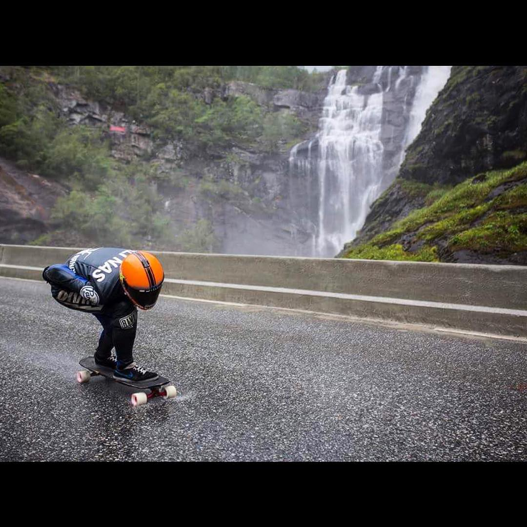 There are worse places to skate than Norway. @ali_nas enjoys a wet run past a roaring waterfall in Voss. Photo: @andreberntsen #divinewheelco #divinewheels